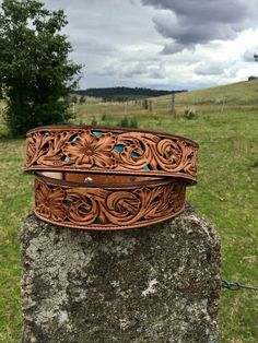 Turquoise floral underlay belt made by DustyCowgirl Leather  Like us on Facebook