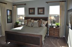 Great window treatments that frame the wall where the bed fills the wall space in between 2 windows