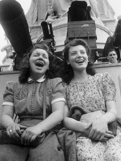 Two young women celebrating VE day on the Victoria Memorial outside Buckingham Palace, London, 8th May 1945. Original publication: Picture Post - 1991 - This Was V E Day In London - pub. 19th May 1945 (Photo by Kurt Hutton/Picture Post/Hulton Archive/Getty Images)