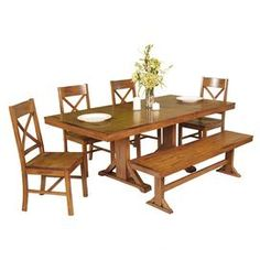 "Finished in antique brown, this 6-piece set adds versatile appeal to your dining room or kitchen–4 crossed back chairs evoke farmhouse style, while a bench and extendable table offer space for family and friends.     Product: 1 table, 1 bench and 4 chairsConstruction Material: WoodColor: Antique brownFeatures:  X-back detailingStrong, trestle style legsRemovable leaf Dimensions: Table: 30"" H x 77"" W x 40"" D (with leaf)Chair: 39"" H x 21"" W x 18"" D eachBench: 8"" H x 60"" W x 14"" D"