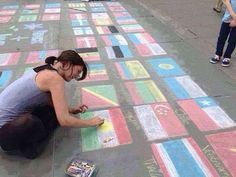 One of the british girl she is drawing kurdistan flag