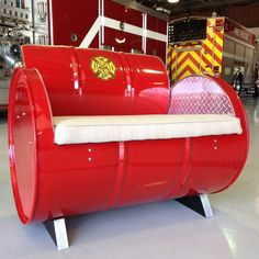 Features: -Fire truck red finish with brilliant simulated diamond plate accents. -The sunbrella fabric covered cushion simulates the hose bed. -Metal edges are de-burred to perfection. -Storage co