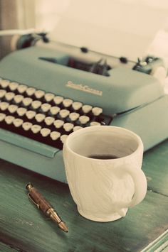 Vintage Typewriter and White Coffee Cup. Love a pretty writing space! #writer #author #writingdesk