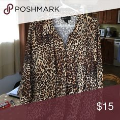Cheetah Print top Cheetah print button up top.  3/4 sleeve.  95% coot on, 5% spandex.  Stretches a bit.  Never worn. Lane Bryant Tops Button Down Shirts