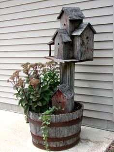 whiskey barrel planter and birdhouses - such perfect primitive/rustic decor! from sangaree_KS's media