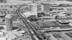 """Las Vegas Strip's """"Four Corners"""" c. 1978. The strip at Flamingo Rd, with Desert Inn (now Bellagio) in the lower left, Barbary Coast under construction in the center, Flamingo Capri's Imperial Tower visible rear right, and Galaxy Motel on the lower right."""