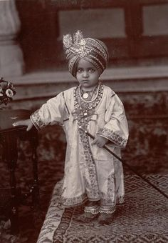 little maharaja in full attire. traditional costume of India. late 19th- early 20th century photo