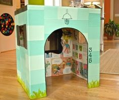Super cute playhouse! I love the decoupage interior; what a great use of old magazines or books! only i'd butch it up for G. lol