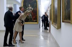 Máxima wears a Valentino dress. Click on the image to see more looks.
