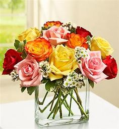 Tired of the same old vase try Multi-Colored Modern Roses. call or click..  480-988-2880  www.weddingbycatherine.com