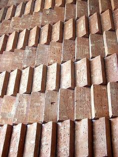 Interior Design Addict: regular unit size - subtle difference in colour & texture of each brick - rotation adds depth & shadow + scale - adds texture & rhythm: | Interior Design Addict