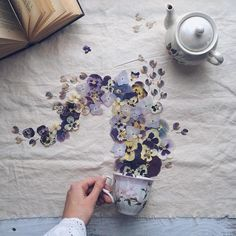 Tea lover Marina Malinovaya arranges flowers and leaves in a whimsical way.