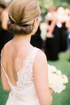 White and Gold Wedding. Bridesmaid Hair. Side rolled and bottom tuck under - Bridal updo