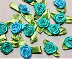 RR-101 $1.25 Assorted Teal Ribbon Roses