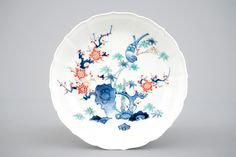 A Japanese kakiemon porcelain fluted plate, 18th C.