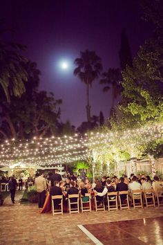 My dream wedding is when it is pitch black outside, with a million little lights to look like sunrise :)