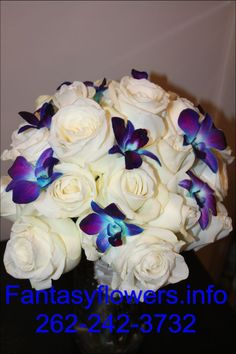 Small orchids and white roses.