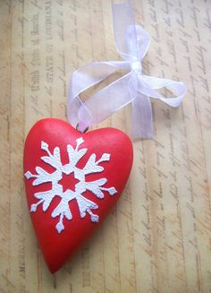 Christmas ornament: wooden heart painted red, with white snowflake or doily