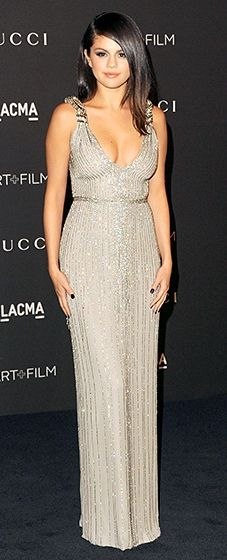 Selena Gomez feted the star-studded affair in a shimmering grey Gucci gown with sparkling striped accents.