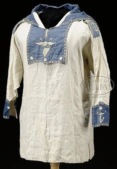 """FABULOUS EARLY AMERICAN SILK EMBROIDERED SAILOR'S JUMPER.  This early to mid 19th Century sailor's blouse is thought to date circa 1830-1840. This Summer weight jumper is totally hand stitched. The blue trimmed panels have fabulous silk designs applied most likely by a sailor at sea and falls into the category of """"sailor art""""."""