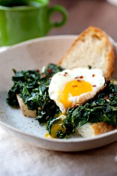 These easy Spinach Breakfast Bowls have a creamed spinach base served over chunky bread with a crispy fried egg. Simple comfort food done right! Breakfast Bowls, Breakfast Recipes, Breakfast Spinach, Breakfast Toast, Cooking Games For Kids, Creamed Spinach, Morning Food, Healthy Recipes, Healthy Breakfasts
