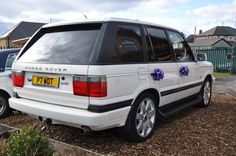 Range Rover P38 with purple bows.