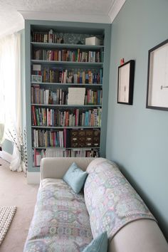 The painted bookshelf makes it look built in (actually I think it is) but still good to know that painting is bookshelf same as walls may help to make it look built in