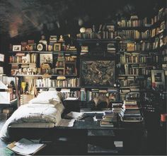 Boho interior: Surrounded by dreams and books. Via At The Corner Down The Street