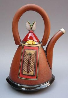 Hennie Meyer. Ceramic teapot. This ceramic teapot, to me, looks just like a purse. You have the handle and then the lid and the front, as if it was the buckle and the design on the purse. Innovative to use a purse as an inspiration for a ceramic teapot
