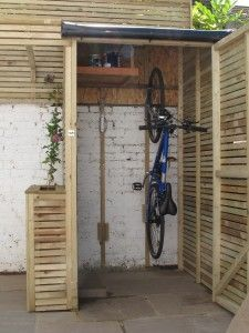 vertical bike storage |  under the deck 4 bikes across. Room enough for gear and tools.  This just might work more room in the garage and build this next to green house