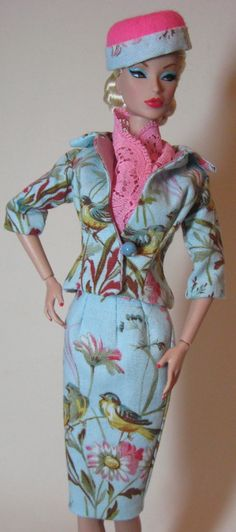 Ready for spring? Victoire is modeling a new robin's egg blue suit with song birds and flowers!