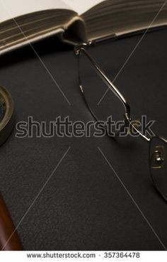 Ophthalmologist concept with book, eyeglasses and magnifying glass. High resolution image.