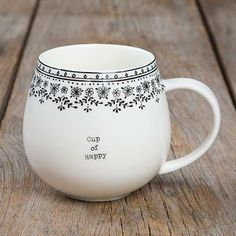 """Cup of Happy"" Mugs - This ""Cup of Happy"" Mug is so cute! It features a large handle, simple font and a fun and original border at the rim? making it a sweet gift for friends and family!"