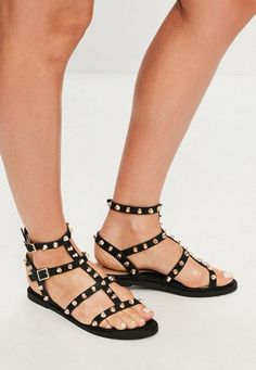 Flat sandals in a black hue with gold studded detailing and gladiator style. upper: other materials lining: other materials sole: other materials Black Gladiator Sandals, Studded Sandals, Leather Sandals, Flat Sandals, Flats, Sandals Platform, Greek Sandals, Wedge Shoes, Rose Gold Shoes
