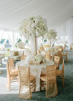 Over the Top Glamour is Totally on Trend.  And you can't go wrong with elaborate white and gold centerpieces like these made of orchids, roses and feathers designed by Karen Tran.