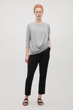 Designed with an asymmetrical drape coming off the shoulder a2dcef9edab6a