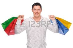 Full isolated studio picture from a young man with shopping bags Stock Photo