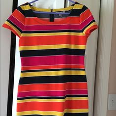 Banana Republic Dress Vibrant stripped dress from Banana Republic.  Never worn, bought 2 and decided to keep the size 8.  Comes from a smoke and pet free home. Banana Republic Dresses Midi