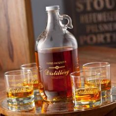Personalized Distillery Glass Growler Jug Set with 4 Low Ball Glasses is traditional but with a contemporary twist perfect for the bachelor party, office set, or moonshine drinker.