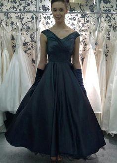 Fairy Goth mother, black satin tea length gown.