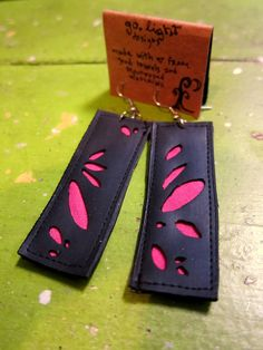 Tire tile earrings - Made from repurposed bike tubes and fabric. $14.00, via Etsy.