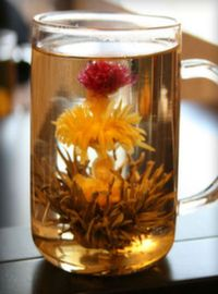 Blooms green tea with chrysanthemum and amaranth flowers.
