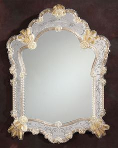 Venetian mirror framed in hand-etched glass with gold highlights, trimmed with glass ribbons and rosettes; Murano glass mirrors; Venetian glass mirrors