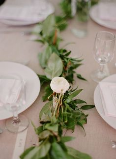 leafy garland table runner // photo by Anna Page Photography // http://ruffledblog.com/english-inspired-milwaukee-wedding