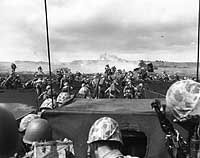 Fourth Division Marines begin an attack from the beach on Iwo Jima, as another boatload of men is disgorged onto the beach by an LCVP, 16 February 1945.  After 36 days of fighting, the U.S. finally overtook Iwo Jima, at a cost of the lost of 3,600 U.S. marines.