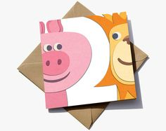 2nd birthday card for a boy or girl. The number 2 is in the negative space between a pig and a lion.  The cute characters have the appearance of sugar paper giving them a playful quality that children will love.