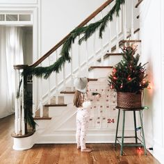 """Somebody talked her way into staying home from school today because she """"doesn't feel berry good"""" which means we are staying in pajamas & watching the grinch on repeat. ☕ But first, turn on all the Christmas lights."""