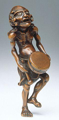 Ryukei I (Japan)   Melanesian Drummer, late 18th-early 19th century  Netsuke, Wood with inlays