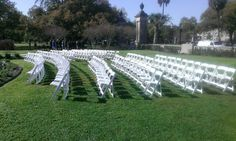 Wedding ceremony near fountain at park entrance on St. Featured are white polymer folding chairs. Outdoor Ceremony, Wedding Ceremony, New Orleans Party, Audubon Park, Backyard Birthday Parties, Wedding Rentals, Folding Chairs, Park Weddings, Corporate Events