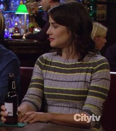 Robin's grey and yellow striped sweater with elbow patches on How I Met Your Mother.  Outfit details: http://wornontv.net/8806/